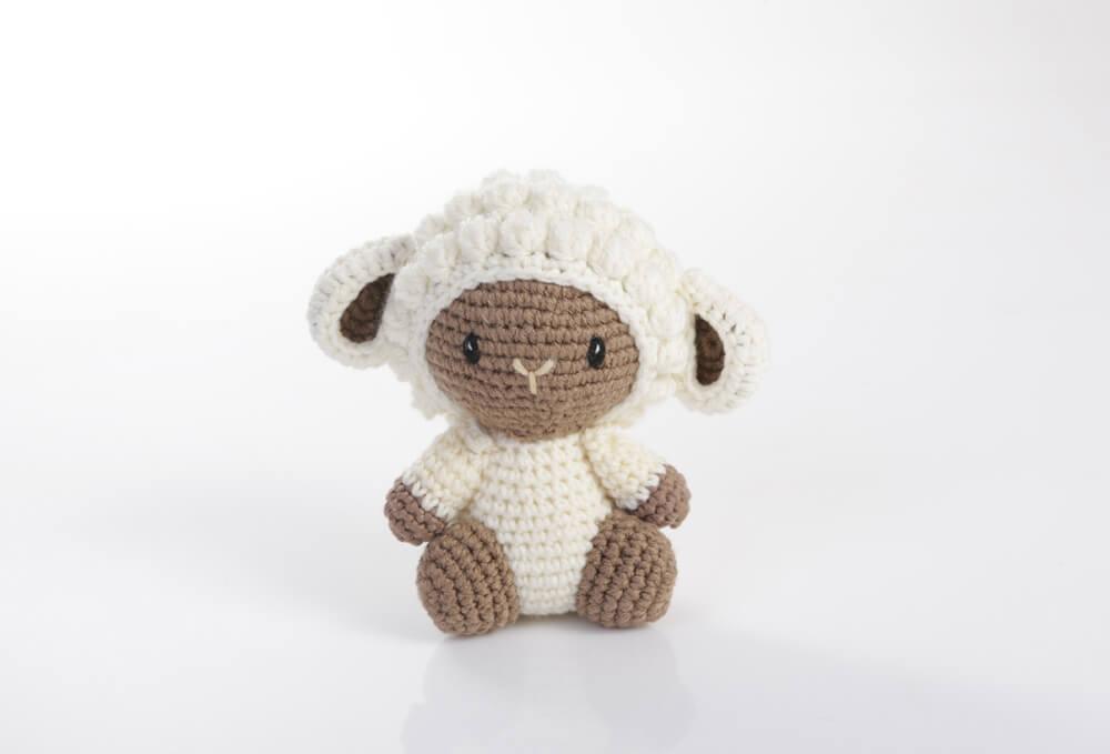 מוצרי טקסטיל - כבשה לבנה עבדות יד